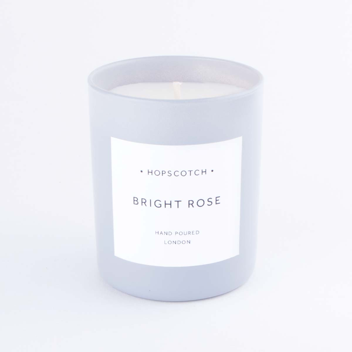grey bright rose candle