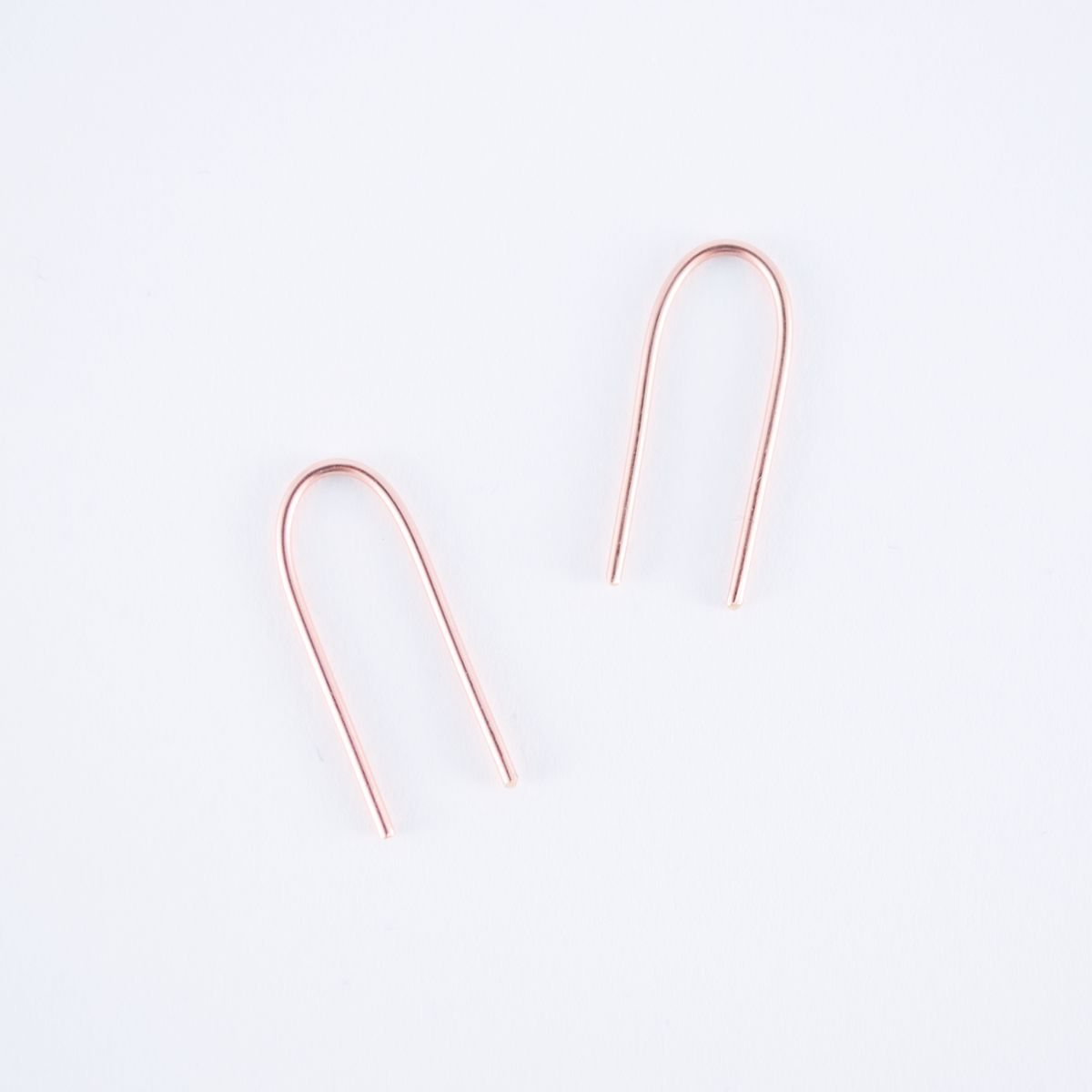 rose gold arc earrings